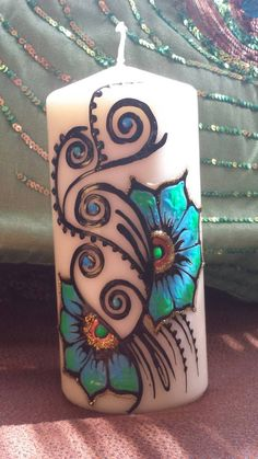 Check out this item in my Etsy shop https://www.etsy.com/listing/177325138/handpainted-henna-candle