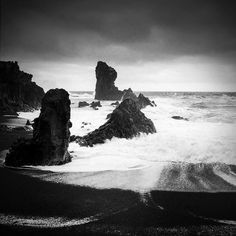 Power of water: Waves crashing agains the cliffs and the black beach of Dritvik, Iceland. Black and white photo with stark contrast, square format. Available as poster, framed fine art print, metal, acrylic or canvas print. (c) Matthias Hauser hauserfoto.com