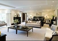 Great way to make a large master bedroom seem cozy - create distinct zones.