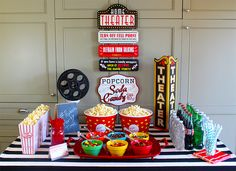 Here are some tips and ideas on how to throw a fun backyard movie party. check out the DIY concession stand and free printable movie party invitation.