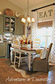kitchen nook green cabinets white table Adventures in Decorating - love the curtains hung up high with the word in between