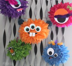 Monstrous Tissue Pom Poms by Persia Lou. Glue on features cut from card stock or foam