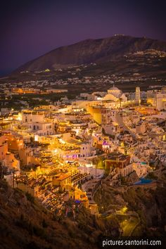 Fira, the modern capital of Santorini at night as seen from the north.