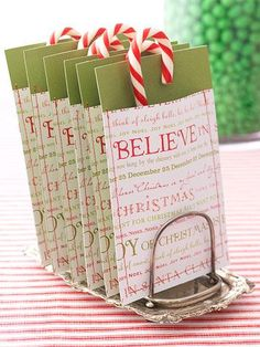 Christmas gift. Make a pocket out of double sided christmas cardstock. Fold and staple on 2 sides. Stick a candy cane inside