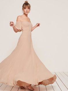 Fancy seeing you here. This is a floor length dress with an off-the-shoulder, sweetheart neckline.