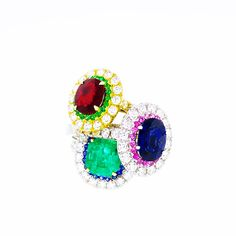 Rubys, sapphires, emeralds, and diamonds in beautiful 18kt. gold settings