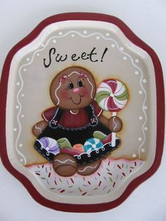 """I painted a cute gingerbread holding a peppermint pop and on her dress is peppermint candies, gum drops and jelly beans. Above her is the word """"Sweet"""" and below her is icing and sprinkles. Around the edge is an icing line and dots.   eBay!"""