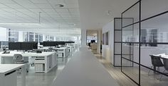 wide work desks, carpet that lines the path Slattery Australia Office, Melbourne by Elenberg Fraser | Yellowtrace.