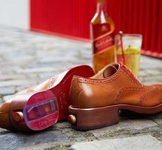 The Oliver Sweeney X Johnnie Walker Brogue ($489) - These sweet shoes have a special compartment in the heel designed specifically to house a Johnny Walker Red Miniature bottle. How's that for genius? The upside is that beyond just the novelty of smuggling Red wherever you step, these shoes also happen to be quite dashing.