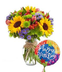 Birthday flowers for mom with sunflowers and tulips delivered with a happy birthday balloon