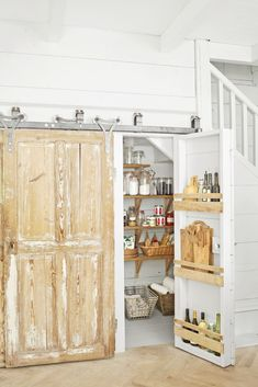 The French Farmhouse Makeover - Blanc Slate - Country Living Back Porch Club Built In Pantry, Built In Shelves, Built Ins, Glass Shelves, Foyers, French Bistro Chairs, Country Living Magazine, Stair Storage, Furniture Slipcovers