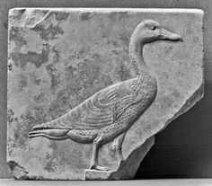 """Known as """"the Great Cackler,"""" Geb was said to have laid the cosmic egg that contained the sun and, thus, was honored as the father of the gods. The image of a goose is also a script sign and was used to write the term """"son."""" This term was an important part of the royal titulary system, as in the title """"Son of Re (sun god)."""""""