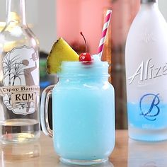 Stoke your sensual side with this Blue Passion Piña Colada, which mixes up rum, Alizé Blue, and piña colada mix.Pineapple slices and a cherry garnish are essential for keeping the piña colada fruit factor nice and high. Pina Colada, Pineapple Rum, Pineapple Slices, Alcholic Drinks, Alcoholic Beverages, Blue Martini Recipe, Cocktail Shots, Cocktails To Try, Aguas Frescas