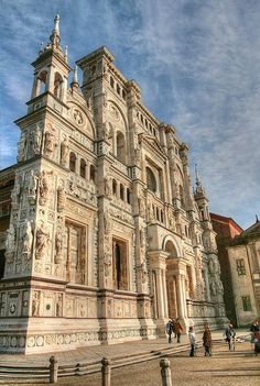 Certosa di Pavia, Italy: was built on a Latin cross plan from 1396-1494, and is one of the largest monasteries in Pavia Province. It is typical of Gothic architecture. It was the reason my German buddy and I stopped there during a trip down the Po River during Carnival weekend in Winter 1985. The church, with a façade that is famous for its exuberant decorations, could be seen from the winding river road. It begged us to stop.