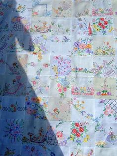 Beautiful quilt from embroidered tablecloths.  You could also get a similar effect from vintage bedsheets, I think (and it would be super soft!)
