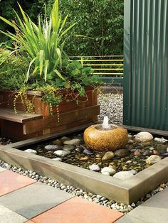 Rooftop Garden in Bainbridge, WA. small bubbler fountain with low, square, rock-filled basin