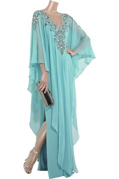 Arctic blue silk-chiffon kaftan with blue and silver-tone embroidered neckline. Marchesa dress has an embellished V-neck and shoulders with beads and crystals, a hook and zip fastening at back, V-shaped front and back panels and a side-split underskirt. 92% silk, 8% lycra. Dry clean.