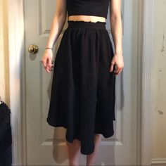 H&M Black Circle Elastic Mid-Length Skirt Size 2 Black skirt from H&M, size 2 and worn once. Great as high waisted with a crop top, length is asymmetrical and is about knee length if not just under the knee. Not lined but has an elastic waist band at the top and is super cute! H&M Skirts Midi
