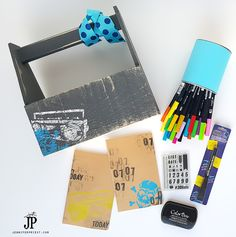 Jennifer Priest shares a kid's art set including a stamp pad, Clearsnap Finger Flair Stamps, a stamped secret journal, and the Clearsnap Secret Message Writer Pen.  This gift set is a fun way to get your kid involved in papercrafts that doubles as storage for their favorite pens and markers as well.