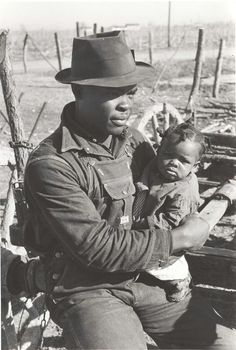 """""""Negro sharecropper and son who will be resettled, Transylvania Project, Louisiana, 1939."""" Resettlement projects usually took folks from horrid temporary camps, or sharecroppers / tenant farmers from exhausted farm land, and gave them """"40 acres and a mule"""" or other assistance. These """"socialistic"""" programs were very unpopular with wealthy landowners, who felt they were being deprived of a captive workforce."""