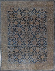 Among the finest of the antique Persian Sultanabad rugs in our collection, the present example ahs a dark blue field beneath a curvilinear beige trellis of leafy vinery and stylized palmettes within a beige border with finely executed palmette vinery.