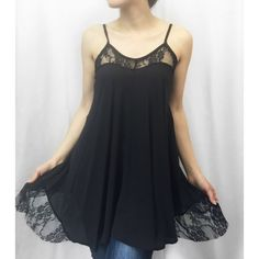 """Lace & Chiffon Asymmetrical Tunic Top MADE IN USA - this STUNNING ASYMMETRICAL chiffon feel thin strap tunic top is delicate and so beautiful. Wear with leggings, denim and more. So beautiful with its flowy bodice and has lace accents at necklace and bottom hem. Get them quick! S(2-4) M(6-8) L(10-12) model is 5'2"""" 115 lbs and wearing size small. 100% poly so won't shrink. Apprx 30"""" long. ValMarie Boutique Tops Tunics"""