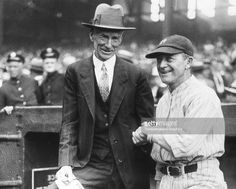 Connie Mack, left, manager of the Philadelphia Athletics and Miller Huggins, manager of the New York Yankees, greet each other before a game in Yankee Stadium in New York City in 1926.