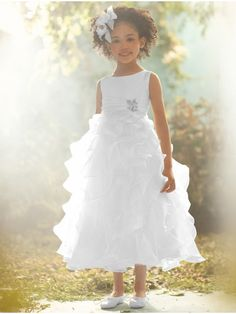 If your dream wedding is Disney-inspired, the Alfred Angelo Disney Blossoms Collection will extend your fairytale theme to even the littlest member of the wedding party. Shown here: Alfred Angelo Jasmine Inspired White Shimmer Organza Dress