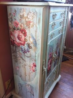 She painted this oak cabinet off white, added some wallpaper, aqua paint wash, and sanded it down! Tada!