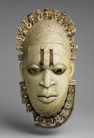 "13-8 Hip Mask Representing an Iyoba (""Queen Mother""). From Benin, Middle Period. c. 1550. Made of Ivory and Copper. height 23.4 cm. Page 412. This mask is important because it represents the Queen Mother who is the senior female member of the royal court.-Ashley"