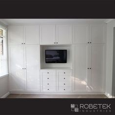 BUILT IN WARDROBE DESIGNS. Built in wardrobe, dressing table and the TV unit all-in-one. The symmetrical design not only looks good but is very easily divided up into his and her sides, no getting in each others way if you both want to get into the wardrobe at once. This wardrobe features satin Dulux Antique White USA polyurethane finish hinged doors, with shaker style routering and federation style handles to achieve a more traditional feel.