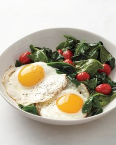 Serve sunny-side up eggs alongside sauteed tomatoes and wilted spinach for a quick, healthy breakfast. Watch our Kitchen Conundrums expert Thomas Joseph show how to make the best sunny-side up eggs.