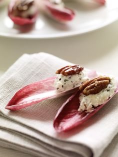 Endive Petals with Rosemary Chevre - The rosemary-goat cheese filling here can be made up to two days ahead. Arrange the finished petals in concentric circles on a large round platter for an elegant flower-like presentation.