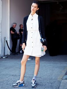 Put on sneakers and a simple black sweater over your basic white shirtdress. // #Style