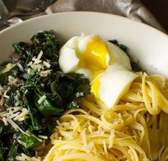Kale pasta with poached egg & a touch of cheese
