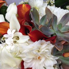 Dahlias, callas and succulents. Throw in some stephanotis for a totally cool and unusual bridal bouquet