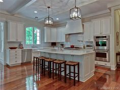 This  large eat-in kitchen with marble counter tops, high end stainless appliances including commercial range, 2 dishwashers, double ovens & warming drawer bring a whole new meaning to personal kitchen!