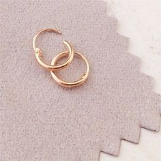 TINY HOOP Earrings or nose rings, ROSE GOLD over silver, 8 mm, endless hoops,nose,cartilage,ears,lips Left Coast http://www.amazon.com/dp/B00N351HT2/ref=cm_sw_r_pi_dp_fnI1vb028YJB0