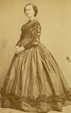 1855-1860 day dress with pleated trimming on bodice, sleeves & lower part of skirt, small collar; cdv