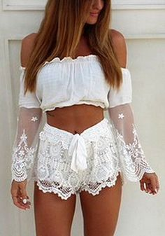 Get that boho chic look with this white off shoulder crop top which features an elastic off shoulder neckline with sheer lace bell sleeves.   Lookbook Store What's New