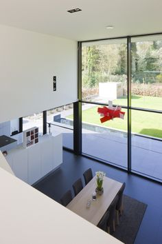 Double level dinning room to open up living room area and bring in more light. House Design, House, Interior Architecture, Modern House, House Inspiration, House Inside, New Homes, Interior Design Kitchen Small, House Interior
