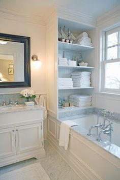 Dream bathroom love love love crown molding and wall paneling. Love the built in storage!