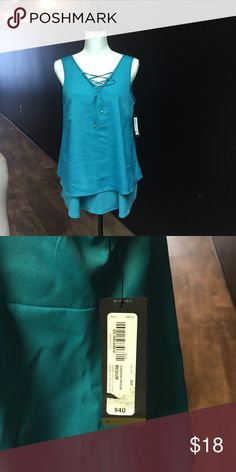 Worthington nwt teal swing top cris cross pattern Worthington nwt teal swing top cris cross pattern  super cute brand new with tags swing top retail 40 Worthington Tops