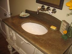 Old Vanity Remodeled to to be a beautiful bathroom sink. Featuring a concrete stained counter top done by our crew