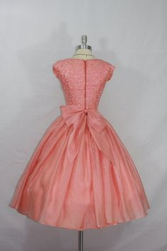 Pink embroidery silk with full skirt dress and huge bow. So girly and gorgeous. 50's dress. This is the back. The front is loaded with pretty embroidery.