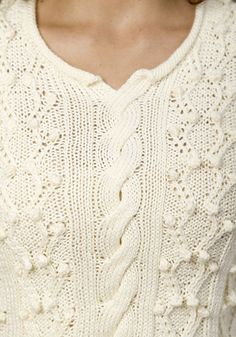 Ravelry: Willow Stream pattern by Ann E. Smith- free pattern- I like the cable down the middle but I'd modify the neckline and take off the bobbles