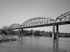 St. Charles Bridge, courtesy the Historic American Engineering Record; This was the first highway bridge connecting St. Charles and St. Louis counties. Built with a wooden deck, it was prone to fires. In 1992, it was made obsolete by a new bridge on Highway 370. The old bridge was demolished in 1997.