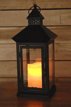 Metal Lantern & Battery Operated Candle with Timer  I wish I could find this at a store! ~Mel