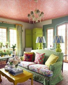 Colourful interior with wallpapered ceiling