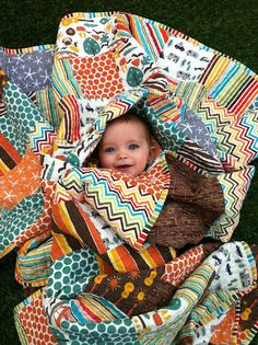 love this quilt and she links where to go for the tutorial!  fabric choices are perfect for a little boy!!!